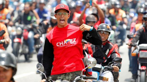 Partidarios del gobierno también reunidos en Caracas. Foto: Reuters / Christian Veron