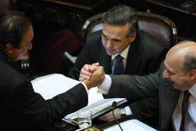 Miranda, Pichetto y Pampuro celebran haber conseguido el quórum para poder aprobar la ley de medios como quería el Gobierno