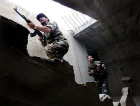 Tropas sirias rastrillan el pueblo rebelde de Dumaya