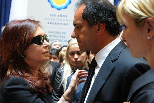 Daniel Scioli y Karina Rabolini, junto a la Presidenta de La Nación. Foto: Presidencia de La Nación
