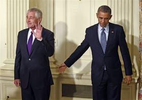 Hagel y Obama, ayer, en la Casa Blanca, luego de que el presidente anunciara la salida del jefe del Pentágono