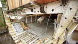 A veces objetos perdidos de larga data aparecen en los compartimientos de carga cuando son desmantelados.
