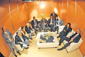 En privado, ayer, Mendiguren, Moyano, Giorgi, Caló, Scioli, Méndez, Randazzo, Tomada, Boudou, la Presidenta y Nicholson