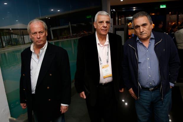 Andrés Rodríguez (UPCN), José Luis Lingeri (Obras Sanitarias) y Juan Carlos Schmid (CGT)