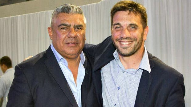 Claudio Chiqui Tapia con Andrés Paton Urich, abogado de la AFA