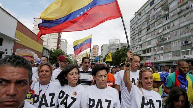 Gran cantidad de gente llega a Caracas para participar de la manifestación. Foto: Reuters / Marco Bello