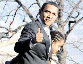 Obama, ayer, junto a su hija Malia