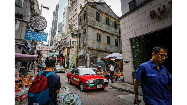 Una vista externa de la ahora cerrado negocio de comestibles Wing Woo en la calle Wellington, que fue construida durante la época colonial en la década , en Hong Kong