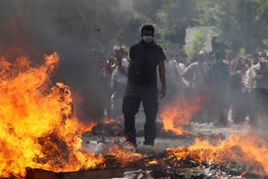 Se cumple la segunda jornada de paro general, el Parlamento de Atenas aprobó el nuevo plan de ajuste con 151 votos. Foto: EFE