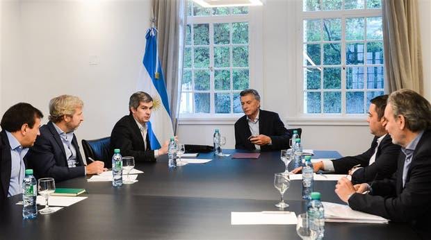 Quintana, Frigerio, Peña, Macri, Triaca y Lopetegui, ayer, en Olivos, durante una reunión de coordinación