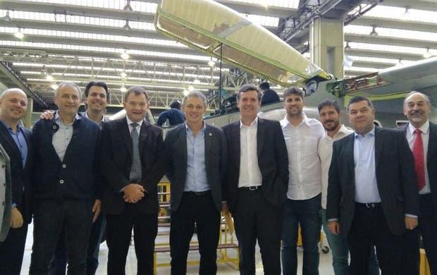 Cabrera y Etchegoyen (en el centro), ayer, junto a industriales