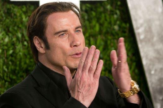 John Travolta, de 59. Fiebre de retoques faciales, pero que le sientan bastante bien. Foto: AFP