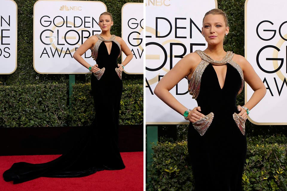 ¡Imponente! Blake Lively con su vestido negro con apliques dorados en mangas y bolsillos de Versace. Otro de los detalles del estilismo de Blake que más comentarios recibió fueron los dos increíbles brazaletes que lució. Foto: OHLALÁ! /Reuters, AFP