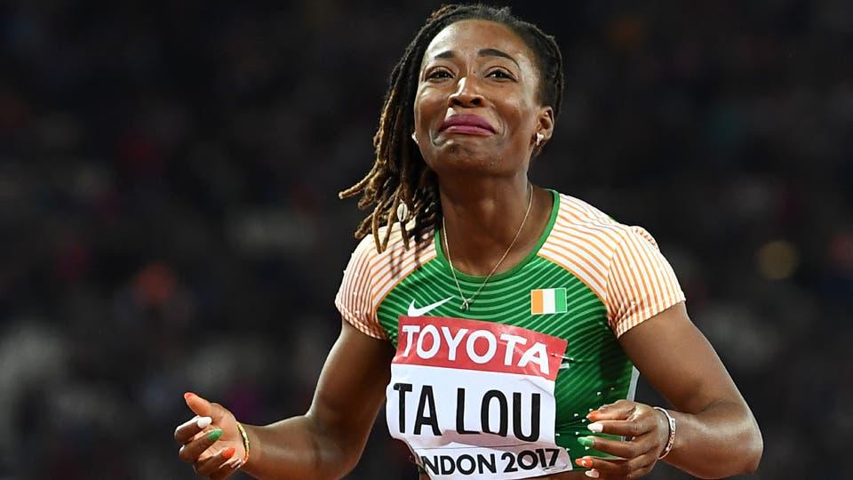 Marie-Josée Ta Lou de Costa de Marfil reacciona después de tomar la plata en la final del 100m femenino. Foto: AFP