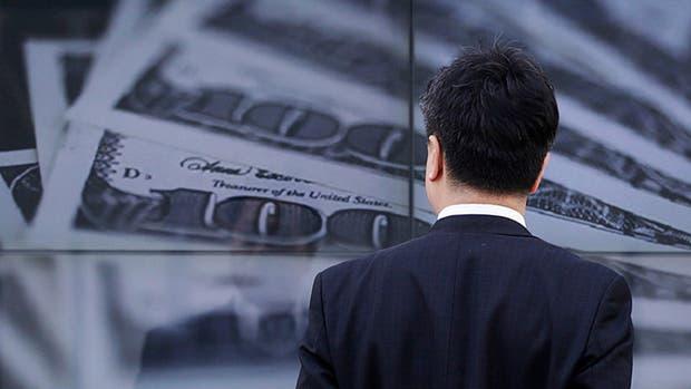 Llueven dólares del exterior pero siguen sin ir a la economía real