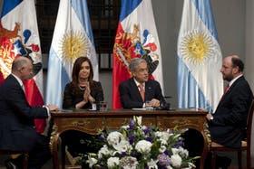 Los presidentes Cristina Kirchner y Sebastián Piñera y sus cancilleres, Héctor Timerman y Alfredo Moreno respectivamente
