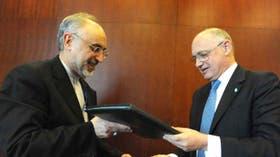 El canciller Héctor Timerman con su homólogo iraní al firmar el acuerdo entre ambos países para investigar la causa Amia