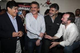 Zannini, Rossi, Filmus y Sabbatella, distendidos y felices, ayer, en la ex ESMA