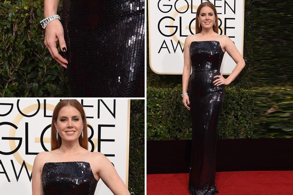 Otro de los vestidos más elogiados de la entrega, Amy Adams con un diseño íntegro en paillettes by Tom Ford. Foto: OHLALÁ! /Reuters, AFP