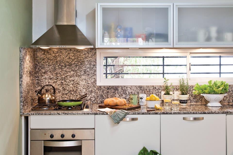 """Una""""enroque"""" entre la cocina y el comedor diario"""