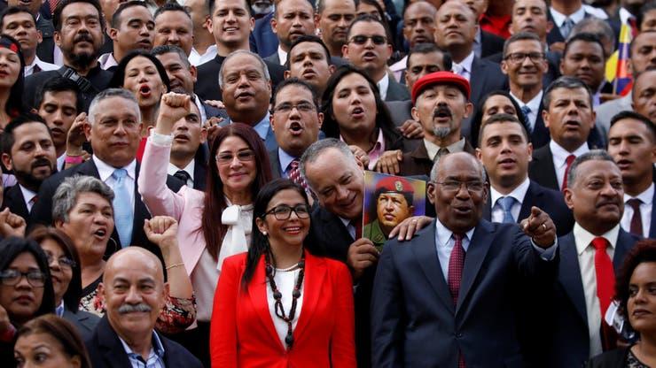 Cilia Flores, Delcy Rodriguez y Diosdado Cabello, con la foro de Chávez, ayer, en el Palacio Federal Legislativo de Caracas