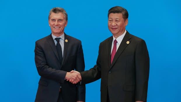 El presidente Mauricio Macri y su par chino Xi Jinping, ayer, en Beijing