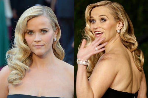 Reese Witherspoon hizo gala de su elegancia, pelo suelto y ondas al agua, al mejor estilo años veinte. Foto: AFP PHOTO/JOE KLAMAR.