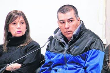 Giménez explains with one of her lawyers