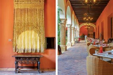 'Sol', el tapiz tejido en cintas de lino con cuero dorado a la hoja es obra de Olga de Amaral, hecho exclusivamente para el hotel.