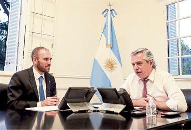 Martín Guzmán y el presidente Alberto Fernández, en Olivos