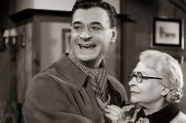 Luis Sandrini con María Esther Buschiazzo, en Cuando los duendes cazan perdices (1955)