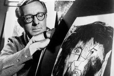 Ray Bradbury. El escritor de ciencia ficción mirando una imagen que era parte de un proyecto escolar para ilustrar personajes en uno de sus dramas en Los Ángeles. 8 de diciembre de 1966