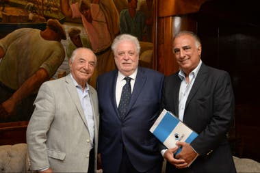 Armando Cavalieri, Ginés González García y Carlos Pérez, de Osecac